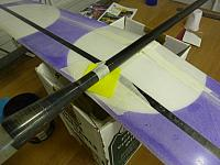 Remember to use a shim cut from parcel tape to prevent stray epoxy gluing the boom to the wing